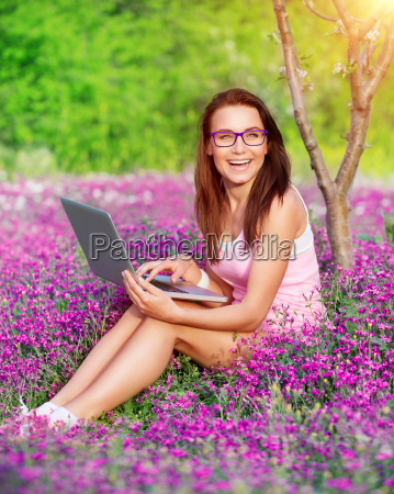 cheerful student girl in the park