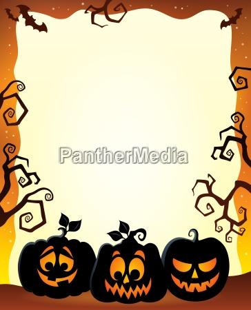 rahmen mit halloween kuerbissilhouetten