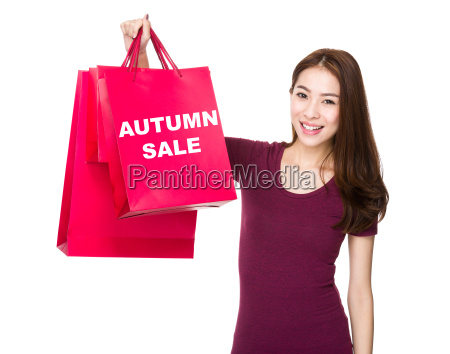 asian woman hold with shopping bag