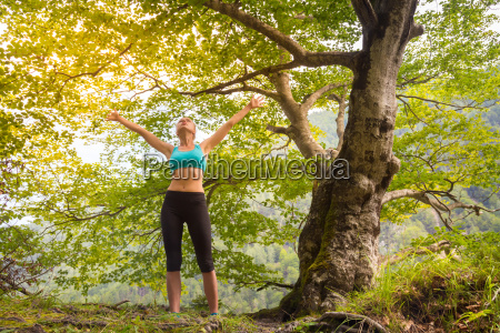 active sporty woman relaxing in beautiful