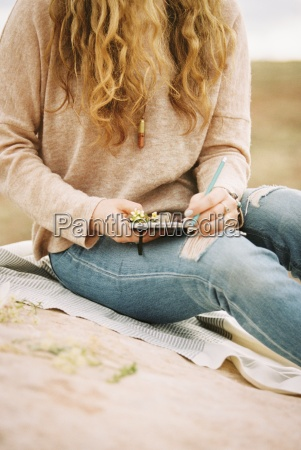 woman sitting in a desert on
