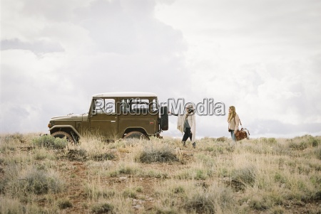 two women by a jeep in