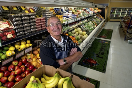 a man standing in a grocery