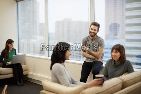 three people by a window in