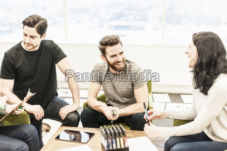four people colleagues at a planning