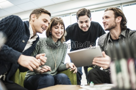 four people colleagues at a meeting