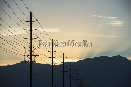 a row of poles and communication