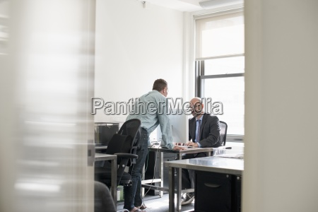 office life two people talking to