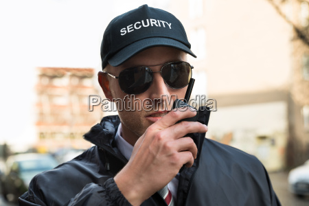 security guard talking on walkie talkie