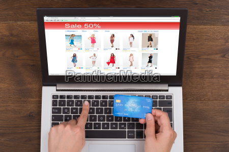 person shopping online with credit card