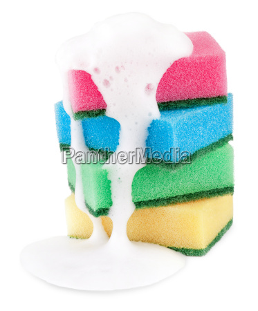 colorful sponges with foam on white