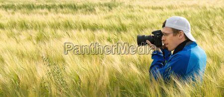 photographer in a field of barley