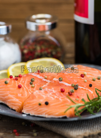 raw salmon fish fillet with wine