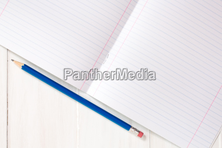 lined notebook with pencil