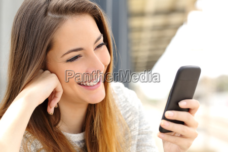 woman browsing media in a mobile