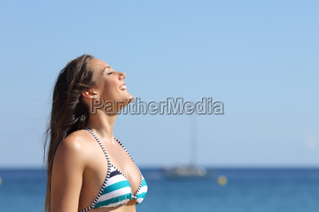 woman breathing in summer vacations on