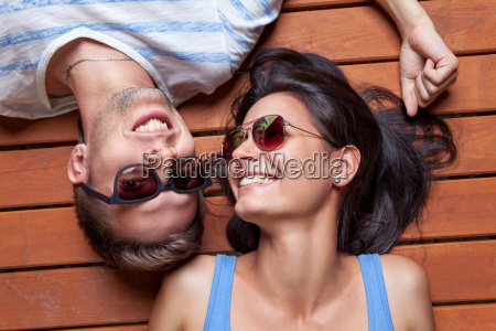 happy young couple lying on a