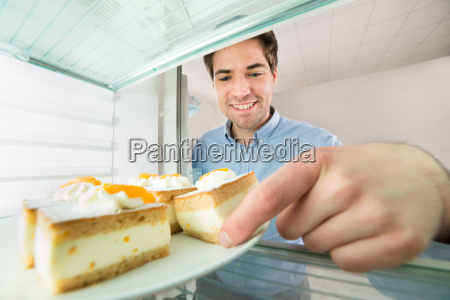 man taking cake view from inside