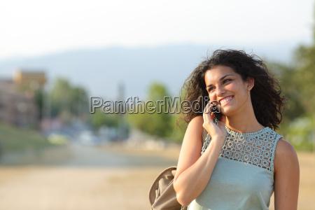 woman talking on the phone walking