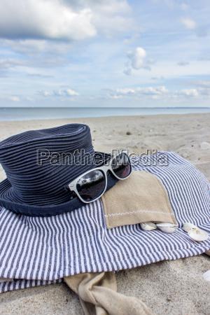 beach bag hat on the sandy