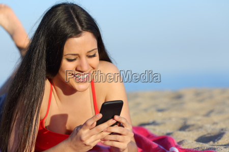 teen girl texting on the smart