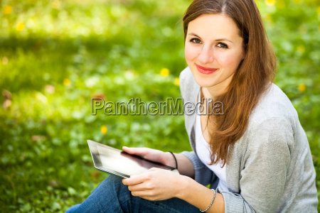 young woman using her tablet computer