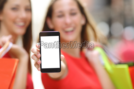 shoppers showing a blank smart phone