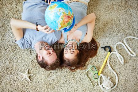 couple with globe
