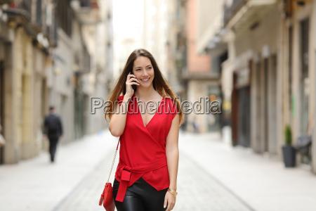 fashion woman walking and talking on
