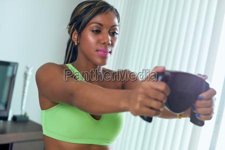black athlete woman measures body fat