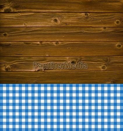 rustikaler hintergrund holz und blaue tischdecke