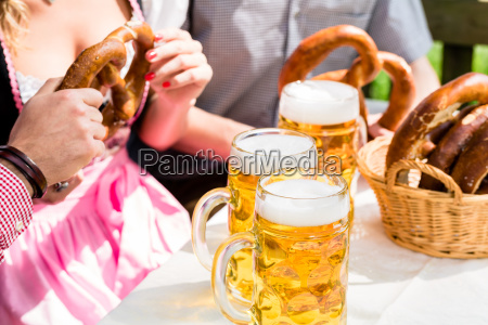 glasses of beer and pretzel in