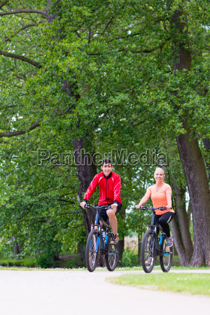 woman and man riding mountain bike
