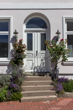 entrance door with summer flowers