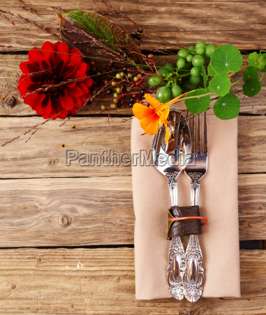 utensils on wooden table with fresh