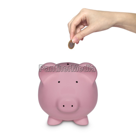 pink piggy bank with hand throws