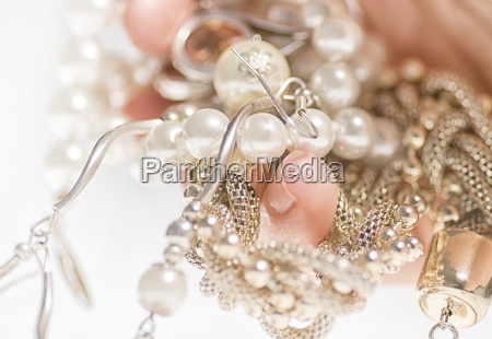 jewelry on hand on a white