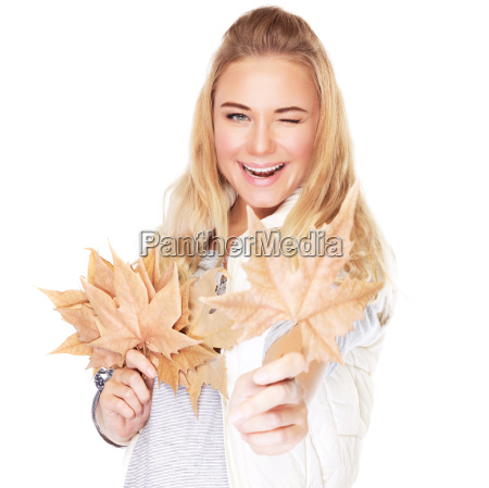 joyful girl with dry leaves