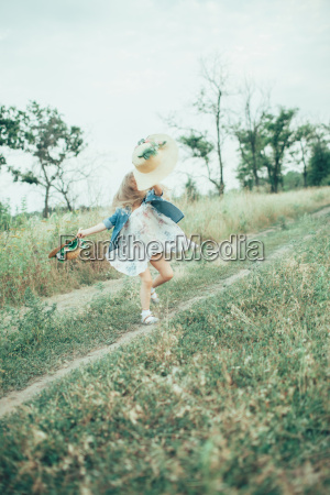 the young girl on green grass