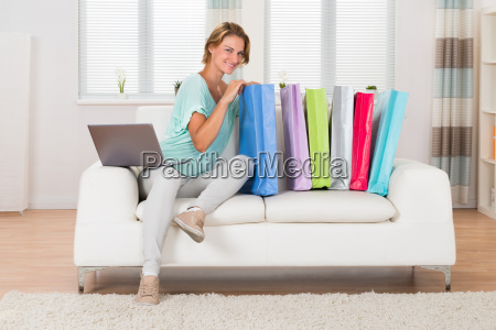 woman with laptop looking at shopping