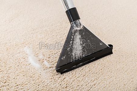 vacuum cleaner on rug