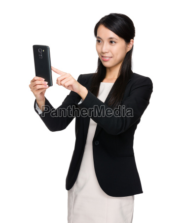 asian businesswoman using the cellphone for