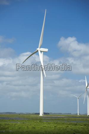 green energy ecology windmill field sky