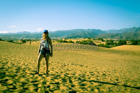 women in the sand maspalomas