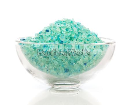 green bath salt in glass bowl