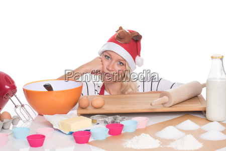 woman with santa hat sitting in