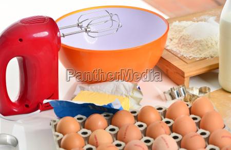 bake baking ingredients and hand mixer