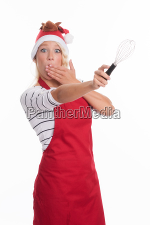 christmas woman in apron showing a