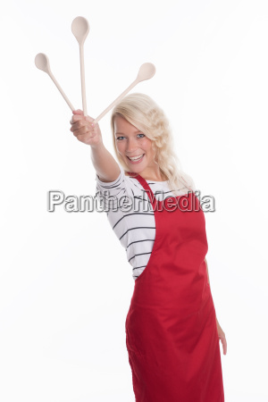 housewife in apron holding different cooking