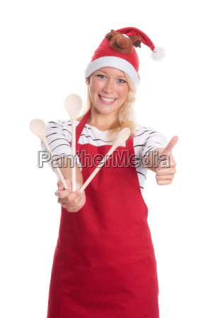 christmas woman with apron shows three